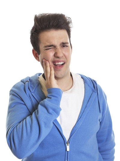 Man holding his face in pain due to tooth loss. This can be fixed with dental implants at Dr. Simon Choyee in Whittier, CA